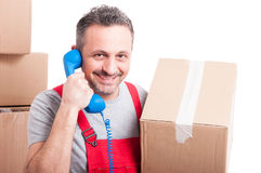 Mover man holding box and big telephone receiver Royalty Free Stock Photos