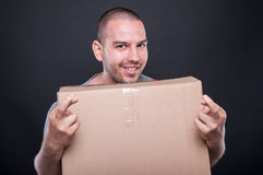Mover man holding box and fingers crossed Stock Photos