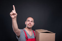 Mover man holding box gesturing touchscreen Royalty Free Stock Photos