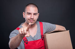 Mover man holding box gesturing touchscreen Royalty Free Stock Image