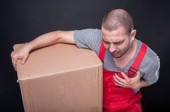 Mover man holding box heaving heart pain Stock Photos