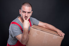 Mover man holding box making look at me gesture Stock Photo