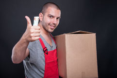 Mover man holding box money and showing like Royalty Free Stock Images
