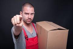 Mover man holding box pointing camera Royalty Free Stock Photo