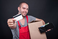 Mover man holding box showing card and money Stock Images