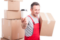 Mover man holding box and showing coffee Stock Photos