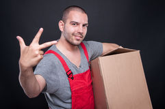 Mover man holding box showing number three Stock Photo