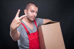 Mover man holding box showing number two Royalty Free Stock Photos