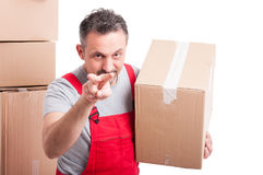 Mover man holding box and showing watching you gesture Stock Images