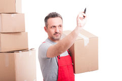 Mover man holding box and writing on invisible board Royalty Free Stock Photography