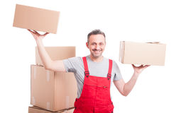 Mover man holding boxes with both hands looking sweaty. And smiling isolated on white background Stock Photos