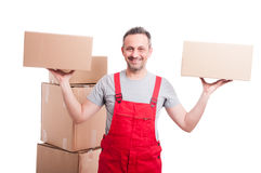 Mover man holding boxes with both hands. And smiling isolated on white background Stock Photography