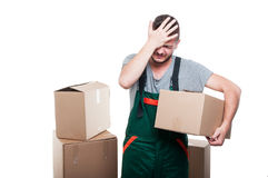 Mover man holding cardboard box gesturing mistake Stock Photography