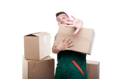 Mover man holding cardboard box gesturing stop. With one hand isolated on white background with copy text space Stock Image
