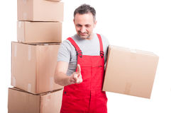Mover man holding cardboard box using invisible touch screen Stock Photo