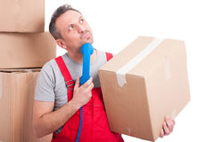 Mover man holding telephone receiver looking for idea Stock Photos