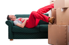 Mover man taking a nap on couch Royalty Free Stock Photo