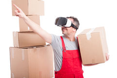Mover man wearing virtual reality glasses pointing up Royalty Free Stock Photography
