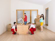 Movers in new house Stock Photos