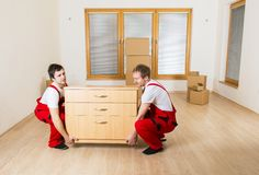 Movers in new house Stock Images