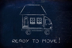 Movers' truck with house on top, ready to move! Royalty Free Stock Photo