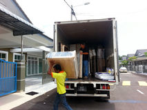 Movers unloading a moving van Stock Images