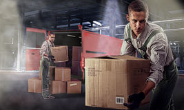 Movers in warehouse. Movers unload products at a large warehouse Royalty Free Stock Images