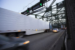 Moves on the bridge blurred semi truck and long trailer Stock Images