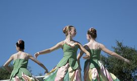 Moves of the three teenage ballet dancers are graceful Royalty Free Stock Images