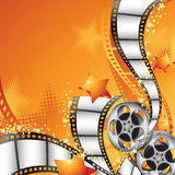 Movie Background. Vector illustration with film reels, strips and lots of small stars Stock Photography