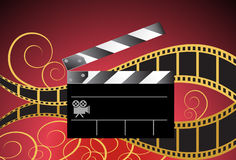 Movie Background: Film Slate Reel. Movie themed background with film, slate, decorative curls and camera icon Stock Photo