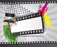 Movie background with place for text. Movie background with filmstrip and director's chair Stock Photo
