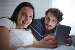 Movie in bed stock images
