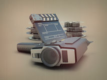 Movie camera on the background of films. With effect DOF. 3d illustration Royalty Free Stock Photography