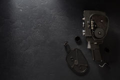 Movie camera at black background. Texture Stock Photography