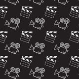 Movie camera and clapper board. Doodle vector seamless Royalty Free Stock Photo