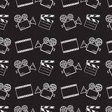 Movie camera and clapper board. Doodle vector seamless Stock Photography