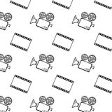 Movie camera and clapper board. Movie camera and film strip doodle vector seamless Royalty Free Stock Photography