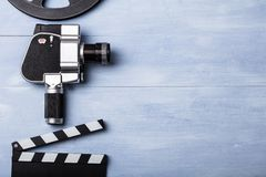 Movie Camera With Film Reel And Clapper Board. High Angle View Of Movie Camera With Film Reel And Clapper Board On Wooden Plank stock photos
