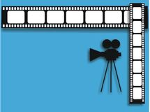 Movie camera and film strip. Blue background with black movie camera shape and film stripe Stock Images