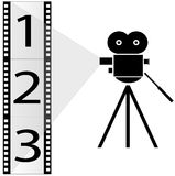 Movie camera and film strip Royalty Free Stock Image