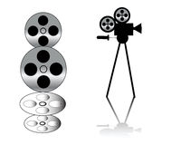 Movie camera and film strip. On white background Royalty Free Stock Photo
