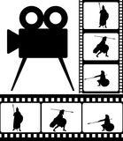 Movie camera and films Royalty Free Stock Photography