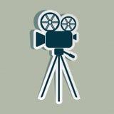 Movie camera icon. Blue retro movie camera icon on striped background Royalty Free Stock Image