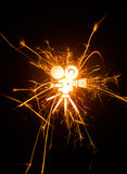 Movie camera icon in glowing sparks Royalty Free Stock Images