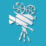 Movie camera icon. White movie camera with shadow on blue background Stock Photo