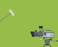 The Movie Camera. Poster on a green background with a movie camera and a microphone. Vector illustration Stock Photo