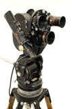 The movie camera and tripod. Professional 35 mm the film-chamber on a white background Stock Photos
