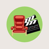 Movie chair and movie clapper flat design Royalty Free Stock Images
