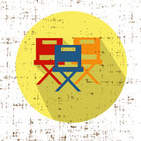Movie Chairs Icon Vector with screen grunge retro texture. Chair Icon Vector retro vintage effect stock illustration Royalty Free Stock Photo